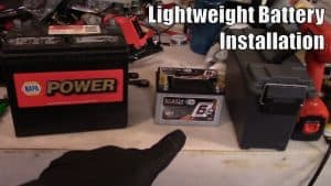 How to install a new car battery with recommended weight